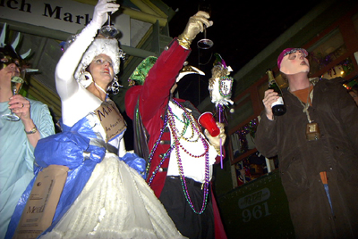 The Phunny Phorty Phellows Boss and Queen toast with officials from the Krewe of Oak to kick off Carnival Season