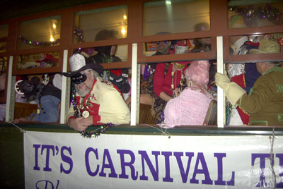 Phunny Phorty Phellows ride streetcar and throw beads to Kick off the Carnival Season