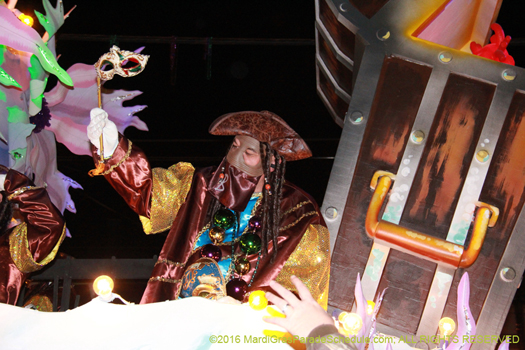 Masked rider throwing beads in the Krewe of Bacchus - photo by Jules Richard