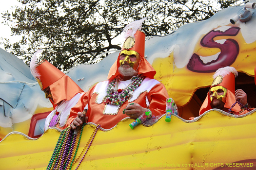 Float riders in the Krewe of Carrollton, Mardi Gras New Orleans - photo by Jules Richard