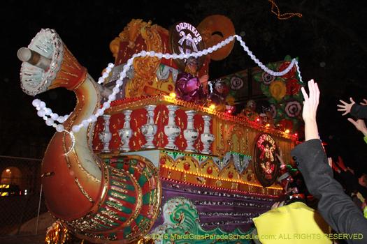 Having Mardi Gras fun at the Krewe of Orpheus - photo by Jules Richard