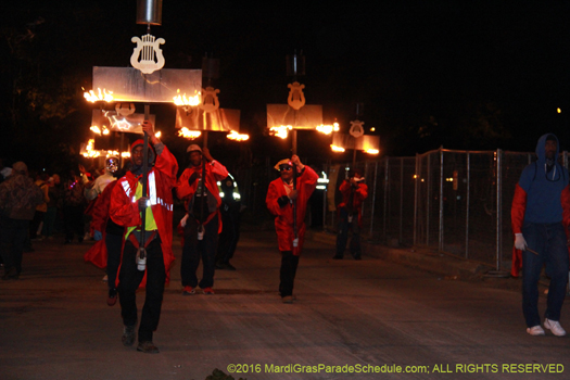 Flambeaux carriers in the Krewe of Orpheus procession - photo by Jules Richard