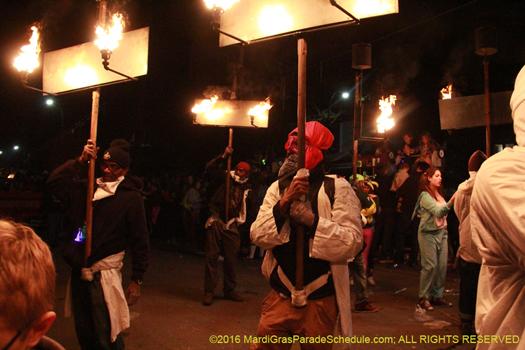 Flambeaux carriers march in le krewe d'etat - phot by Jules Richard