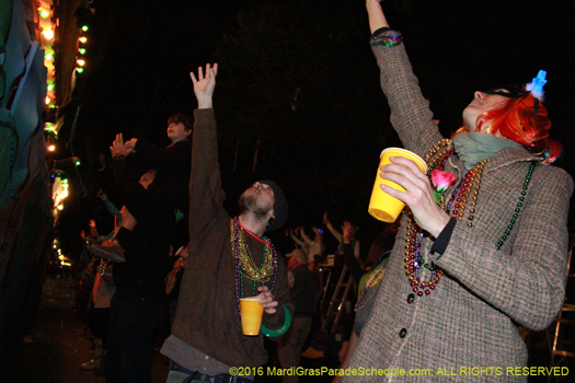Revelers cheer for throws during the Krewe of Cleopatra parade - photo by Jules Richard